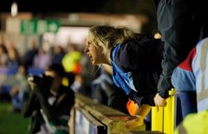 A fan shouts at the away goalkeepr