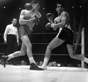 Welshman Brian Curvis catches Gaspar Ortega, of Mexico, clean on the face during their February 1965 fight. Brian Curvis won the fight on points after 10 rounds.