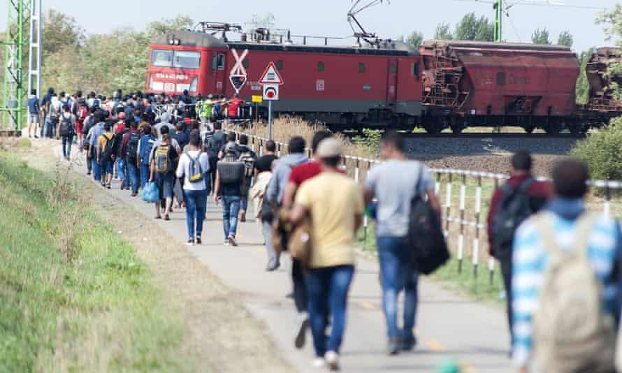 Migrants and refugees  walk toward Austria near Hegyeshalom