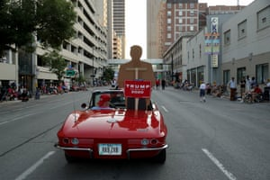 A cardboard cutout of Donald Trump stands in the back of a Corvette as it rolls along with the Iowa State Fair Parade on 7 August 2019 in Des Moines, Iowa.