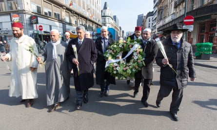 Representatives of Belgian Muslims and other community leaders pay tribute to the victims of the recent terror attacks in Brussels, 1 April.