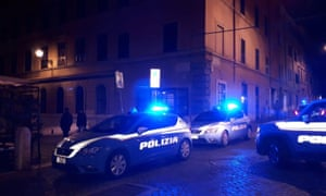 Police cars on a dark street in Rome