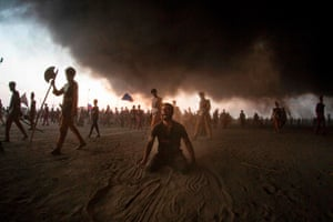 Suq al-Shuyoukh, Iraq. Shia Muslims grieve during the reenactment of the battle of Karbala on the 10th day of the mourning month of Muharram, which marks the peak of Ashura