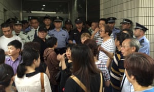 Relatives of Shanghai passengers on board a cruise ship that capsized in central China, attempt to storm a government office to demand information after the tourist agency which organised the tour failed to help them.