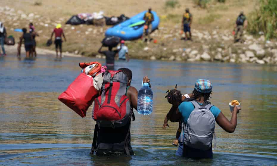 Haitians cross the Rio Grande back to the United States in Parque Ecologico Braulio Fernandez in Ciudad Acuna, Mexico.