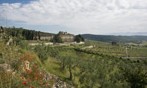 Widescreen landscape view of Torre a Cona, a small collection of apartments and farmhouses just half an hour from Florence
