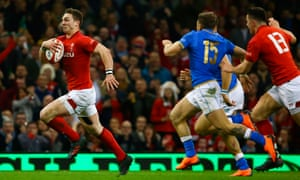 Wales wing George North evades Italy's defence and runs through to score during the hosts' Six Nations victory in Cardiff.