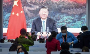 A screen shows Chinese President Xi Jinping delivering a speech via video for the opening ceremony of the 3rd China International Import Expo (CIIE) at a media centre in Shanghai on November 4