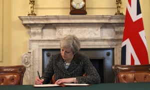 Theresa May signs the official letter to European Council President Donald Tusk invoking article 50 and the UK's intention to leave the EU.
