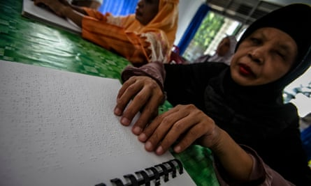 Blind people read braille Qur'ans at a disability rehabilitation centre in Indonesia
