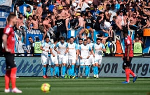 Marseille players celebrate during their 3-1 win at Guingamp this weekend.