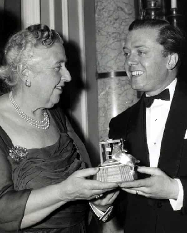 You done it … Richard Attenborough presents Agatha Christie with an award to mark the longevity of her play.