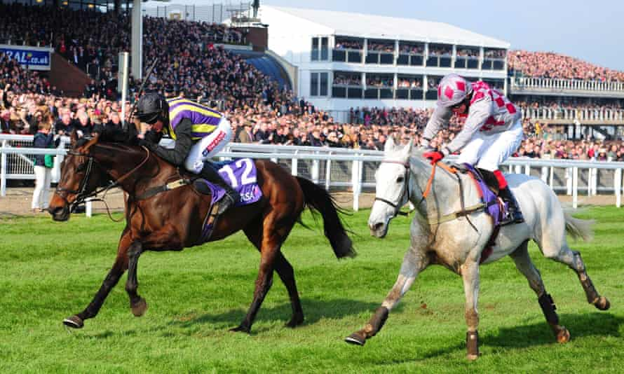 O'Faolains Boy and Barry Geraghty, left, win from Smad Place and Robert Thornton on Ladies Day at the 2014 Cheltenham Festival.