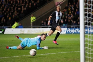 Newcastle United's Joelinton slots the ball past Eastwood.