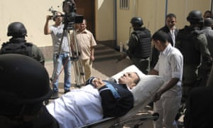 Mubarak being taken into the Cairo courtroom on a gurney in September 2011.