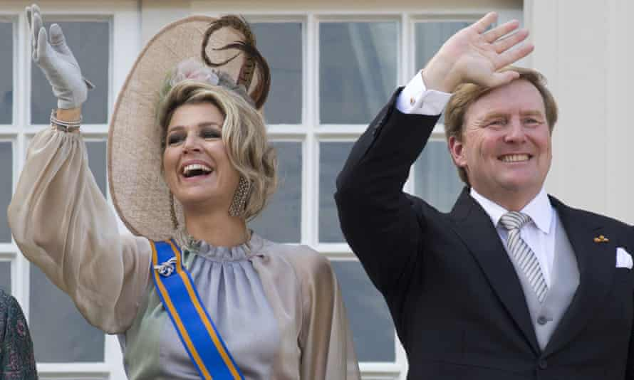 King Willem-Alexander and Queen Máxima wave from a balcony in The Hague