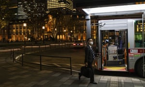 A man wearing a face mask to help curb the spread of the coronavirus gets on a bus near Tokyo Station on Thursday, 12 November, 2020.