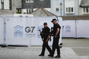 Armed police patrol outside the National Maritime Museum in Falmouth