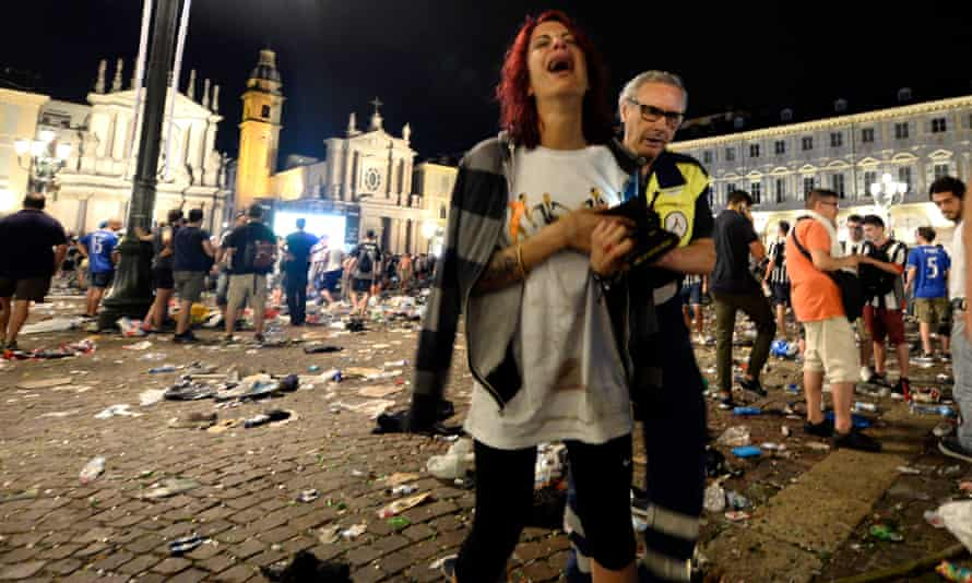 Juventus supporters leave Piazza San Carlo after the stampede.