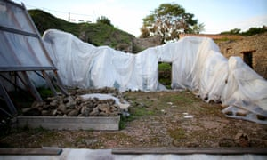 Plastic sheets cover the remains of a house at the UNESCO World Heritage site of Pompeii, October 13, 2015.