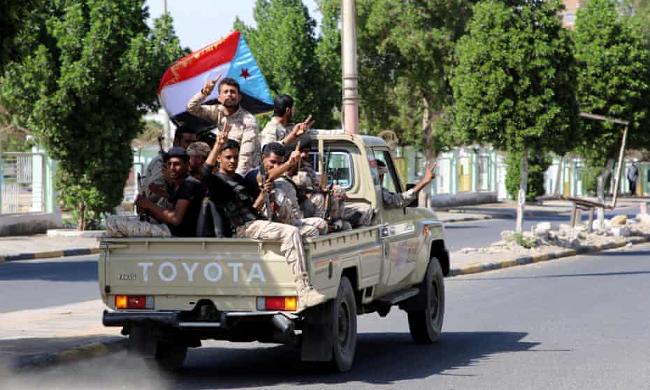 Southern Yemeni separatist fighters flash the V sign as they ride through Aden's streets on Monday.