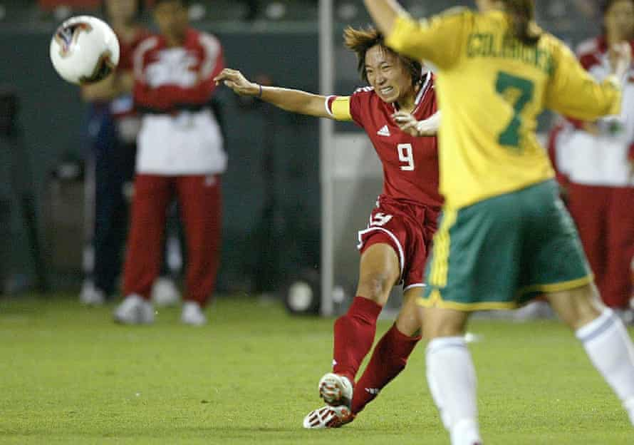 Wen Sun attempts a pass past the Australian defence during the first round of the FIFA Women's World Cup in 2003.