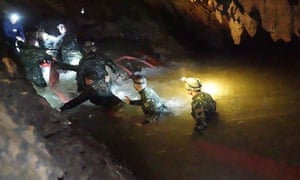 A team of Royal Thai Navy SEAL divers inspecting the water-filled tunnel in the Tham Luang cave.