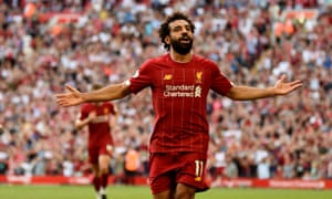 Mohamed Salah celebrates after scoring the third for Liverpool.