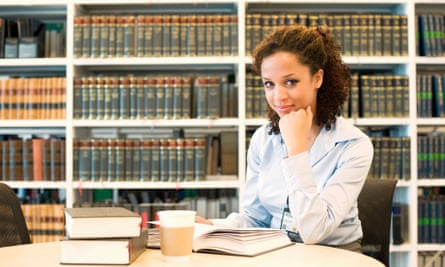 Businesswoman studying in library
