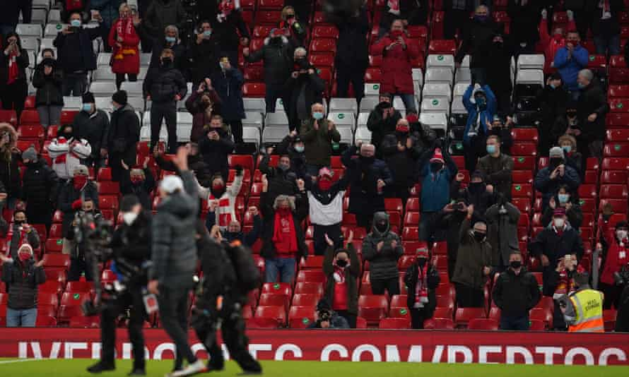 Jürgen Klopp salutes the supporters following the Premier League match at Anfield against Tottenham