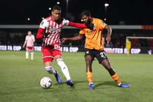 Brentford's Ezri Constance protects Ball from Medite Elito from Barnett.