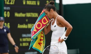 Britain's Heather Watson wipes her face with a towel between points against Germany's Annika Beck during their women's singles first round match on the fourth day of the 2016 Wimbledon Championships on June 30, 2016.
