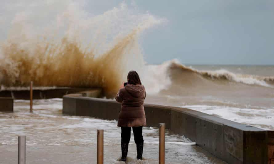 Waves crash against a tidal wall on Thursday in Asnelles, northwestern France.