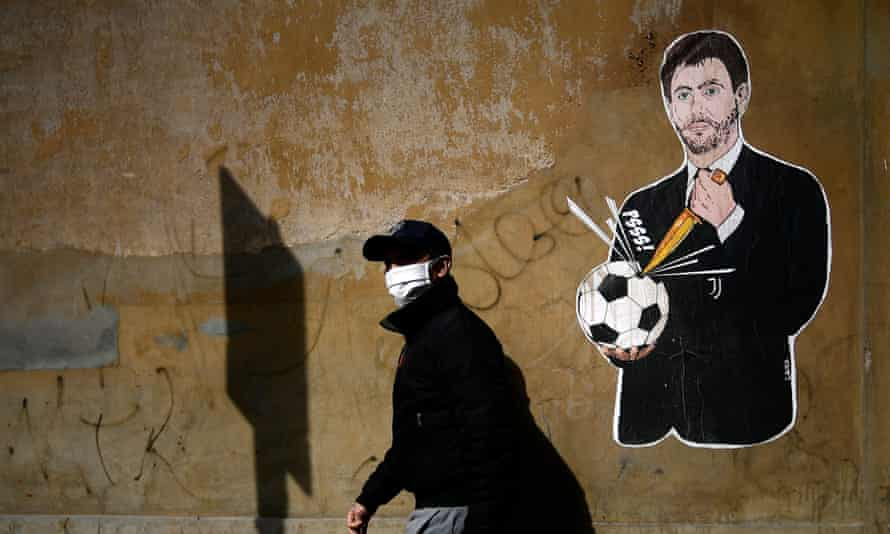 Graffiti showing the Juventus president, Andrea Agnelli, near the headquarters of the Italian Football Federation in Rome.