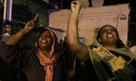 Relatives shout outside Kober prison after the release of opposition activists who had been arrested following peaceful protests against government austerity measures.