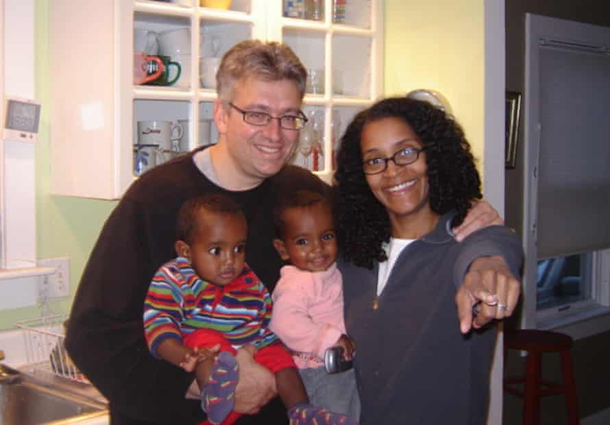 Isabella (left) and Giulia at home with John and Emily Bernard.