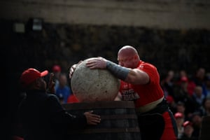 Competitor places heavy rock on barrel