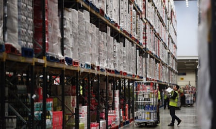 Groceries are prepared for distribution at a Tesco distribution plant in Reading, England.