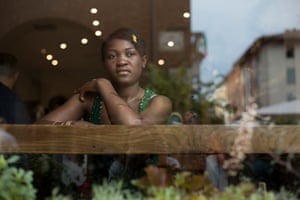 Precious, a 20-year-old Nigerian woman, in a bar in Asti, near Turin.