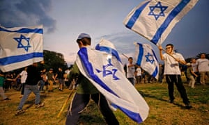 Children wave Israeli flags