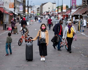 Masked Portraits on Ridley Road by Gideon Mendel