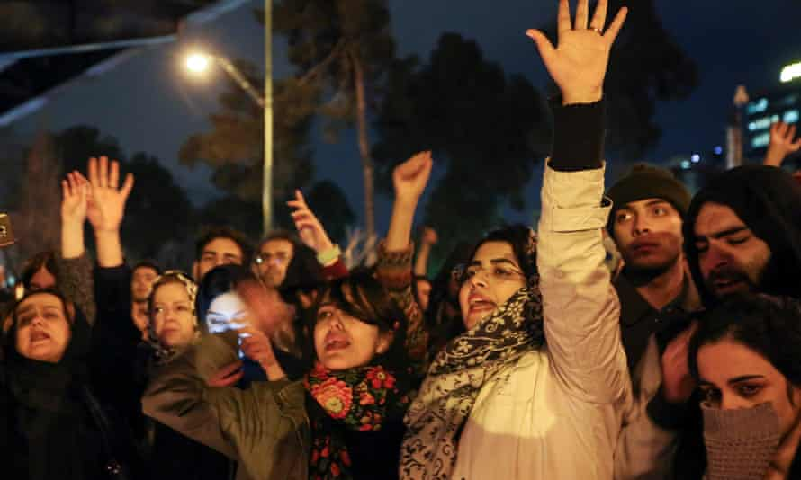 Iranians shout anti-government slogans outside Amirkabir University in Tehran on Saturday after a vigil held for the victims of the Ukrainian plane crash.