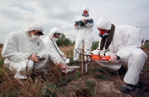 Members of the international mobile radiological laboratories measure soil radioactivity near Ukraine's Chernobyl nuclear plant September 15. Twenty-three mobile laboratories from Austria, Germany, Slovakia, France, Hungary, the Czech Republic and Ukraine take part in international exercises of radiologists, preparing to fight calamities like Chernobyl's in 1986. ds/Photo by Gleb Garanich REUTERS