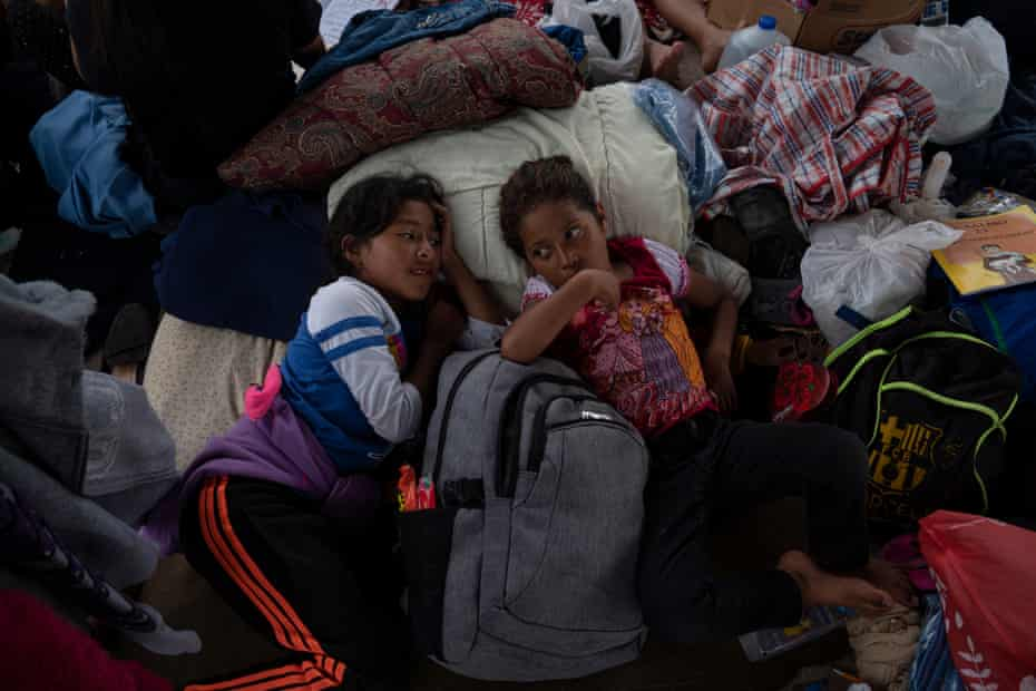 Mexican asylum-seeking girls, who are cousins, rest under a gazebo in a plaza where they have been living for a week in Reynosa, Mexico on March 24, 2021. They were sent back with their mothers after seeking asylum in the U.S. under Title 42 due to the pandemic. Verónica G. Cárdenas for The Guardian