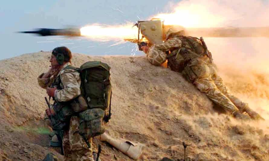 A British Royal Marine fires a missile at an Iraqi position on the al-Faw peninsula in 2003