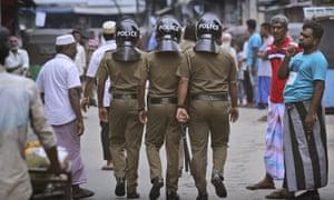 Sri Lanka bombings: at least 15 killed as police raid suspected