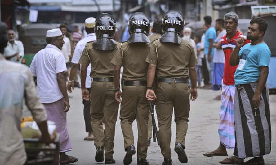 Sri Lankan police on patrol in Colombo.