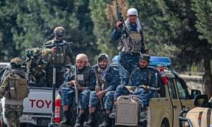 Taliban fighters patrol a Kabul street