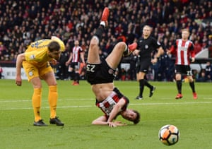 Preston's Paul Huntington watches on as Sheffield United's Ben Heneghan takes a tumble at Bramall Lane, United progress to the next round with the 1-0 win.