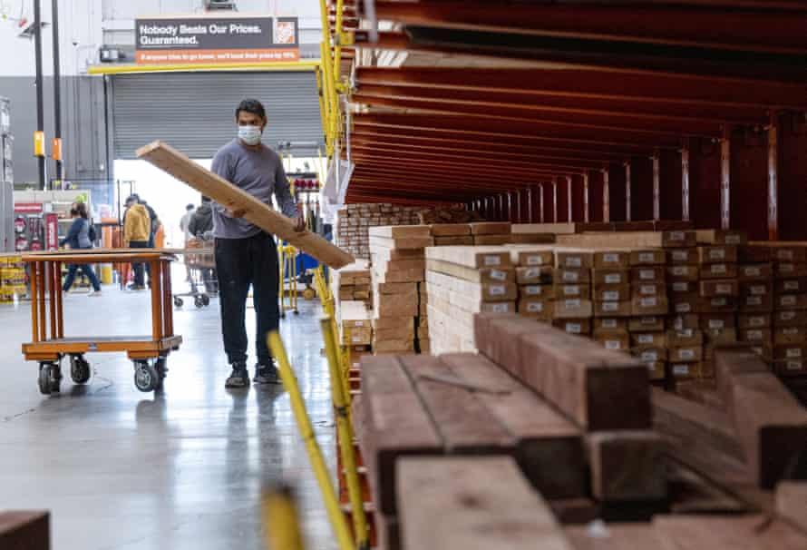 A customer loads lumber at a Home Depot store in Pleasanton, California.
